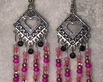 Long pink heart centered dangle earrings