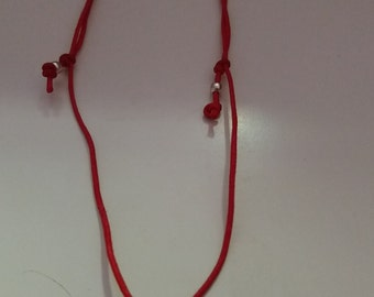 Red choker necklace and silver veneer. Necklace.