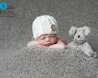Newborn cable stitch beanie with wood button in red alpaca blend