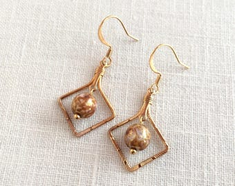 Gold square hoop and bead earrings. Tan glass bead earrings. Diamond hoop drop earrings. Tan glass dangle earrings. Small bead drop earings