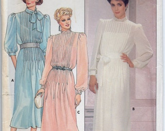 Loose Fitting Straight Dress With Collar Front Tucks Three Quarter Or Long Sleeves With Button Cuffs Size 6 Sewing Pattern Butterick 6945