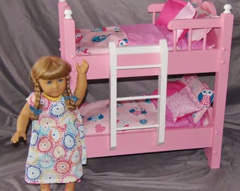 Doll bunk bed fits American girl doll with intricately cut headboards and 10 piece owl bedding set.