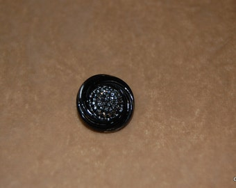 single black glass button with silver highlights