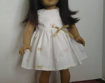 White dress with pink and gold bows