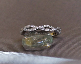 Twisted wedding band, Half infinity pave with diamond simulants, Rhodium plated Sterling Silver bridal ring. LEIA