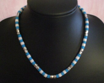 Man white and blue beaded necklace