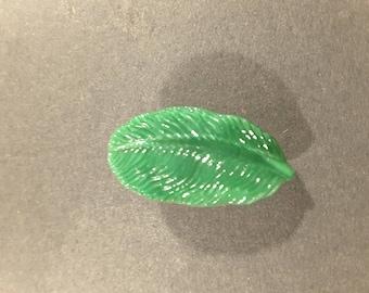 Moon glow glass green leaf button.