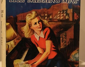 Nancy Drew - The Quest of the Missing Map by Carolyn Keene in White Spine Dust Jacket