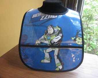 WATERPROOF WIPEABLE Baby to Toddler Wipeable Plastic Coated Bib Buzz Lightyear