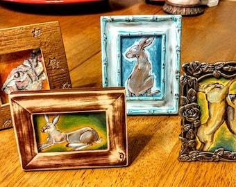 Four mini framed rabbits set