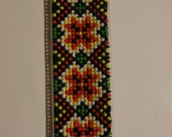 Bookmark on plastic canvas (handmade cross-stitched colorful ornament).
