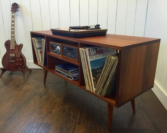 Mid century modern stereo/turntable console, record player cabinet featuring sapele mahogany with tapered wood legs.
