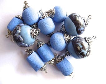 11 mixed blue beads with carved silver metal bead caps