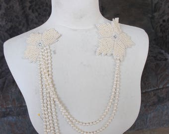 Cute embroidered  and  beaded applique ivory  color