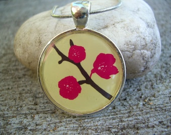 Graphic print cherry blossoms round resin pendant with chain