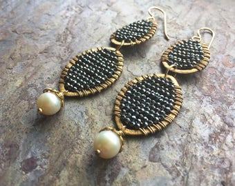 Gold hoop statement earrings with hematite gemstones and freshwater pearls