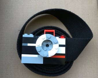 Belt camera made with building bricks