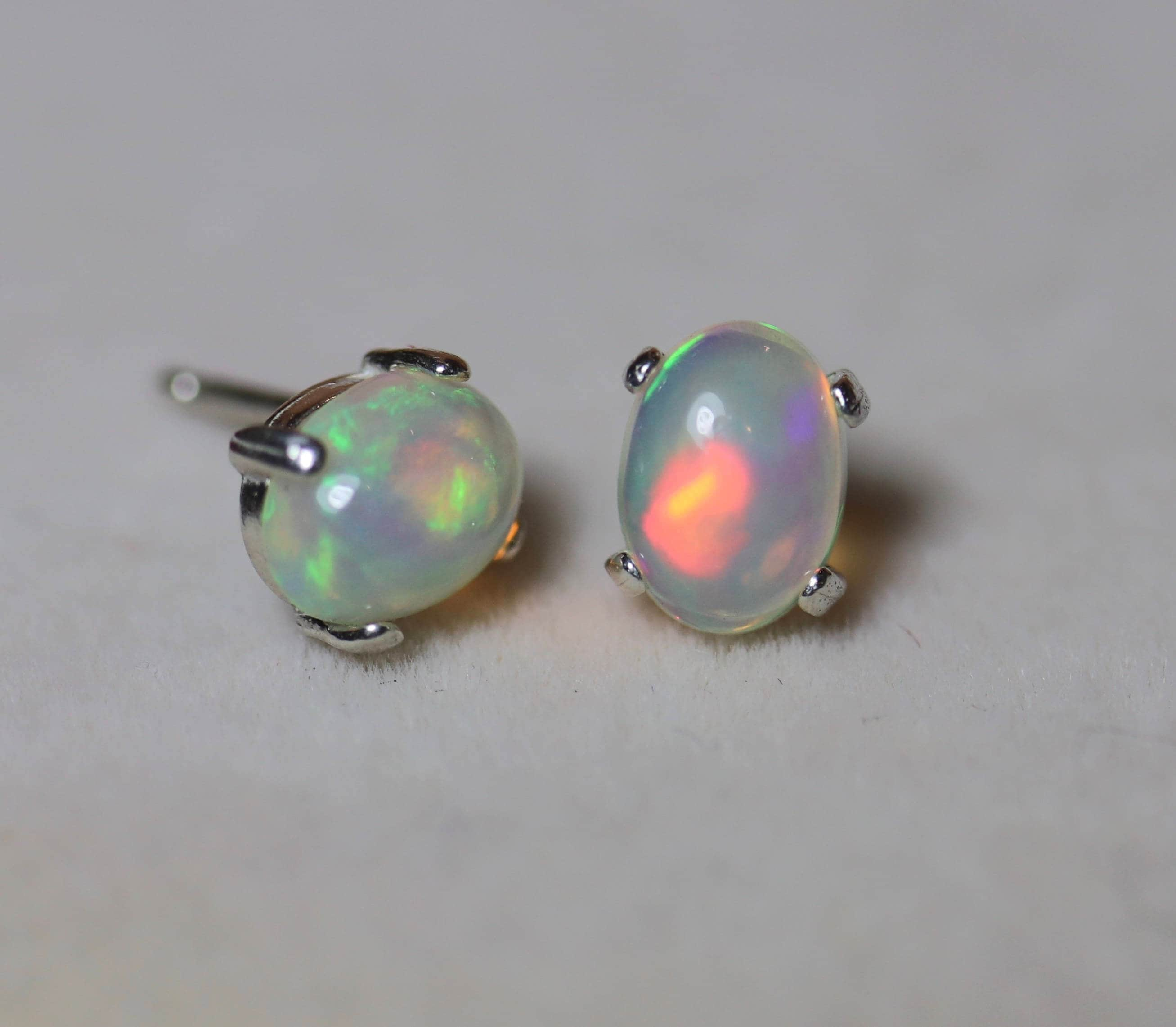 ethiopian gold earrings in white tw opal