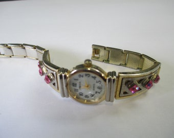 Vintage jewelry Ladies watch Arenix, silver and gold tone with white pearlized face  used good condition