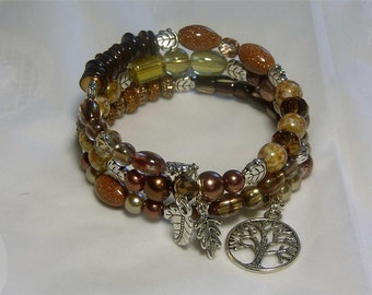 "Cynthia Lynn ""CHANGES"" Autumn Brown Gold Mixed Bead Silver Tree Leaf Spiral Coil Charm Bracelet"