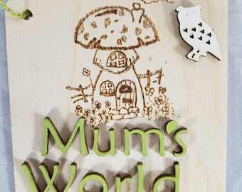 Lovely handcrafted handmade fantasy forest pyrographic drawn mushroom house wirh mum's world sign plaque stick to cupboard or use as a gift