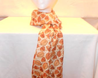 Beige long scarf with light brown leaves