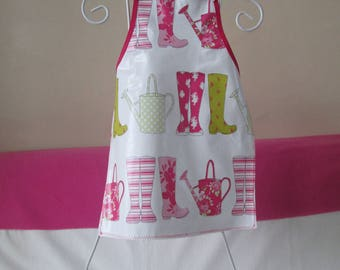 Child's oilcloth apron: 6/8 years