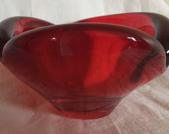 A ruby red vintage glass bowl