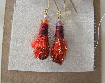 Feathery Fiber Bead Earrings Red with gold metallic bits. Crystal detail on top.