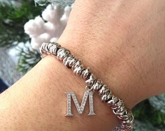 Bracelet with knot in silvered aluminum and initial in silver 925 with zircons
