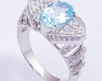 Handmade 925 sterling silver ring, In this ring swiss blue topaz faceted in oval cut prong setting.