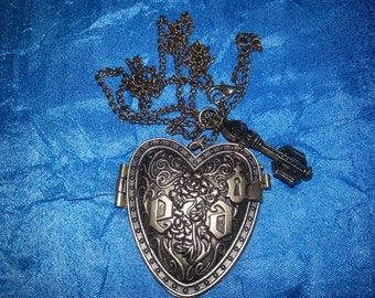 A charming pendant in the form of a heart on a chain with a key. The key to the heart