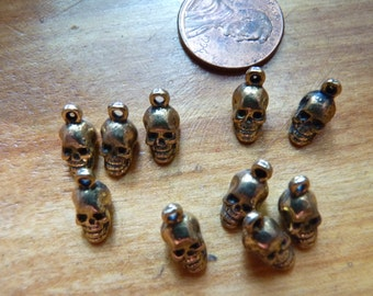 Solid pewter skull charms