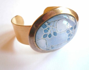 Gold bracelet cuff. Abstract blue apples. Modern gold brass bracelet cuff with handmade glass pendant.