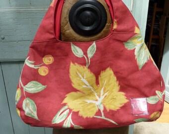 Leaves red handbag