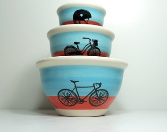 NESTING mixing bowl set for the Cyclist, colour blocked in sky blue & red-orange. Made to Order.