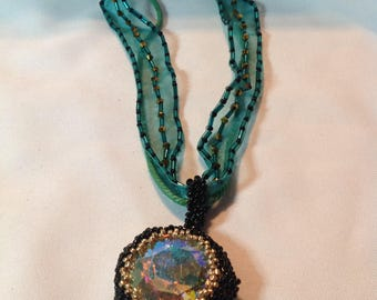 Sparkling green pendant necklace on organza ribbon with bicone sand seed beads