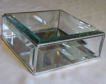 A clear beveled glass display box 6 x 6 x 2 inches for your treasures, memories, and keepsakes