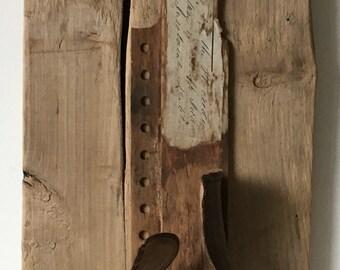 LEATHER PIECE no.1: found object assemble, sculpture, folk art, outsider art assemblage
