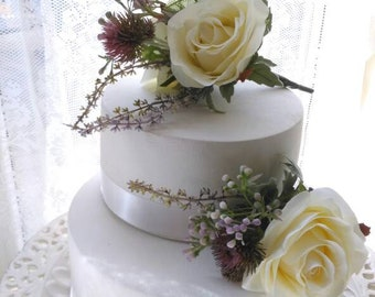 Silk Wedding cake flowers with Scottish Heather Thistles Fern's purple wax flowers Ivory Roses. Cake toppers.