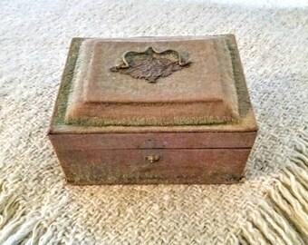 Antique green velvet jewelry box .