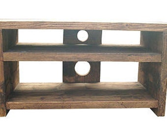 TV stand / unit finished in rustic medium oak with a  double shelf