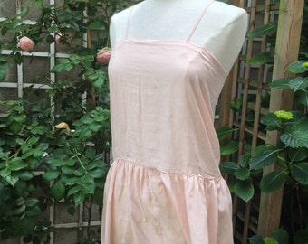 Pale pink silk camisole, under dress from the 1920s.