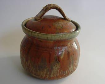 Small ceramic lidded pot.