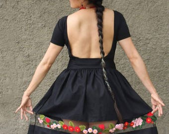 Black Skirt size M. Pyma Cotton fabric, flowers from Ayacucho, Arpilleria. Lourdes Chambi design one of a kind handmade in Peru
