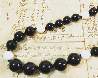 Vintage handknotted black and white  glass bead necklace