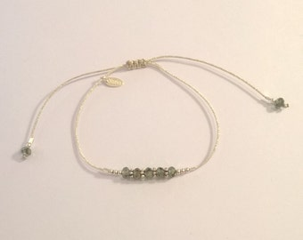 Japanese silk cord and gray-green swarovski crystal bracelet