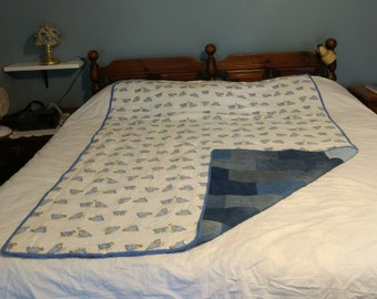 Nap time?  Count sheep on this flannel blanket with recycled denim for the back. QT44