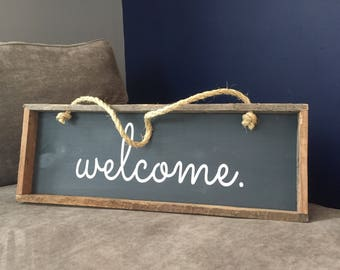Welcome sign. Framed in reclaimed wood with a rope hanger.
