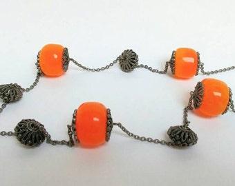 Long vintage faux amber hippie necklace.